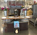 Picture of Rusty Relics 2018 Vintage Market's Welcome booth made from wine barrels & wood counter